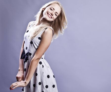 Fashionable blond girl smiling