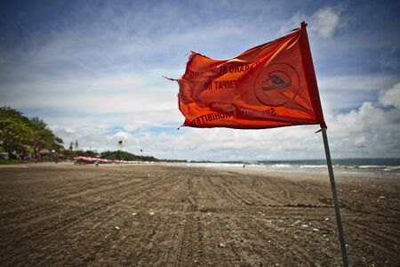 Warning red flag on a strong wind   photo