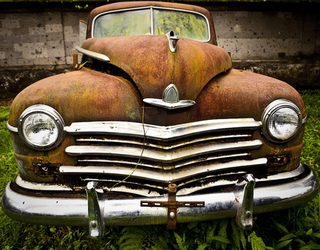 rusty car: Grunge and hight rusty elements of old luxury car  Photo