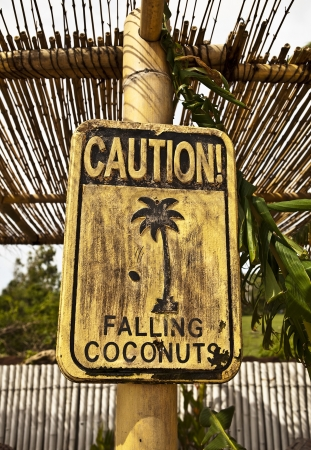 Old funny wooden caution sign on the beach   photo