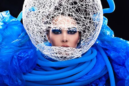 Futuristic beautiful young female face with blue fashion make-up Stock Photo - 15576626