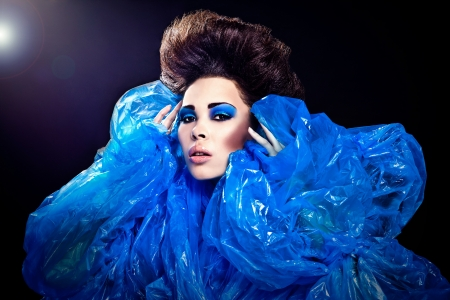 Futuristic beautiful young female face with blue fashion make-up Stock Photo - 15576621