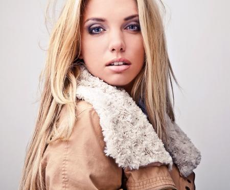 Amazing beautiful blond woman on fur   Stock Photo