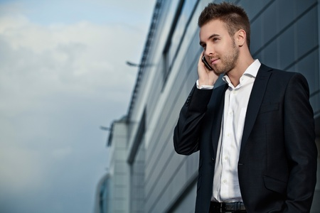 Portrait of a cheerful young businessman Stock Photo - 15575103
