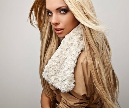 Amazing beautiful blond woman on fur   Stock Photo - 15596471