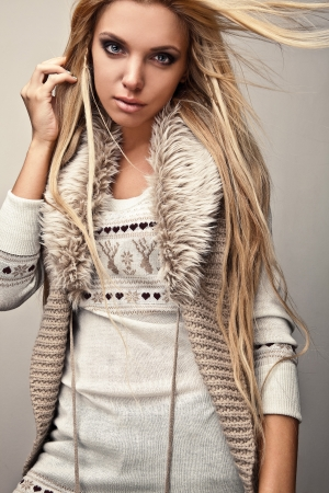 Amazing beautiful blond woman on fur   photo