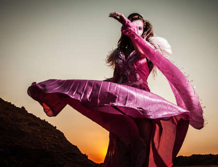 Attractive romantic woman on beautiful pink dress pose outdoor Stock Photo - 15598916