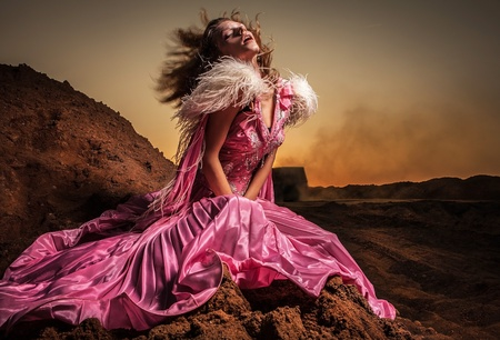 Attractive romantic woman on beautiful pink dress pose outdoor   photo