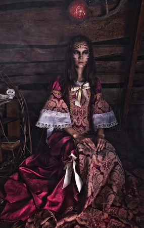 psychologically: Fine art photo of a young fashion lady in a dark mystic location