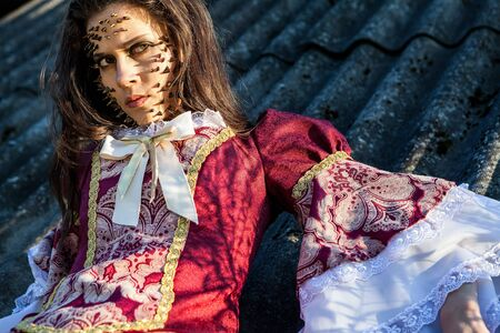psychologically:  a young fashion lady in a dark mystic location