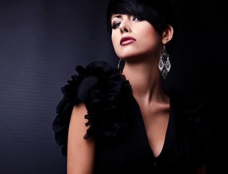 Beautiful woman on black classical dress pose in studio Stock Photo - 15635713
