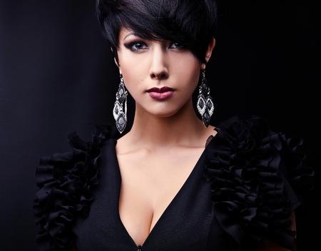 Beautiful woman on black classical dress pose in studio Stock Photo - 15587651