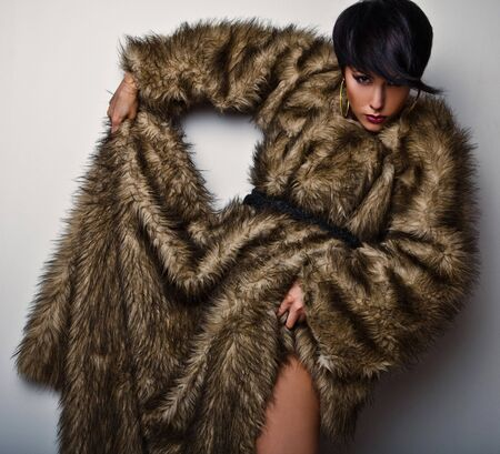 Elegant fashionable woman in fur  Fashion photo   photo