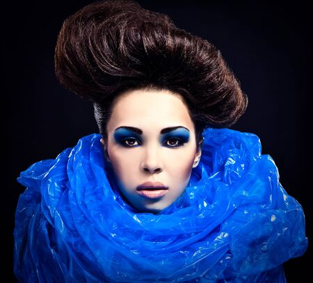 Futuristic beautiful young female face with blue fashion make-up   Stock Photo - 15588067