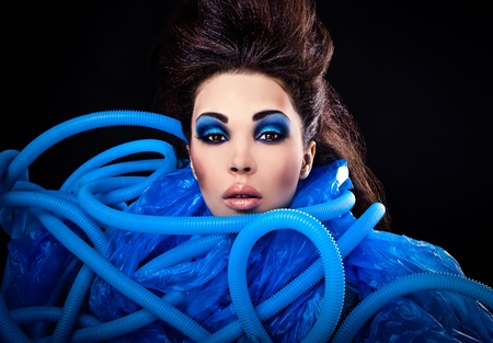Futuristic beautiful young female face with blue fashion make-up   Stock Photo - 15587881