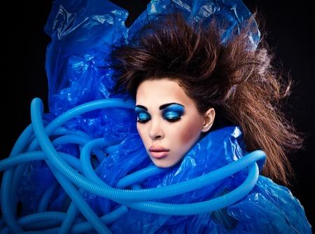Futuristic beautiful young female face with blue fashion make-up Stock Photo - 15588093
