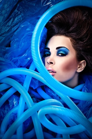 Futuristic beautiful young female face with blue fashion make-up Stock Photo - 15587879