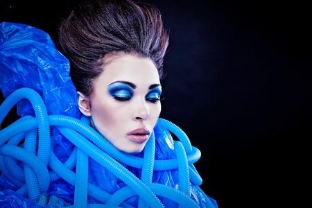 Futuristic beautiful young female face with blue fashion make-up Stock Photo - 15587995