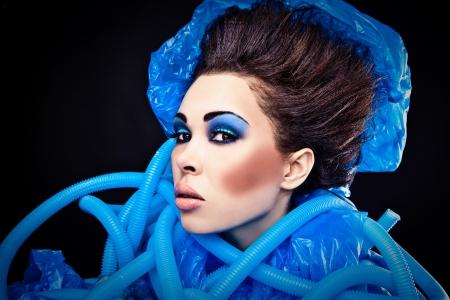 Futuristic beautiful young female face with blue fashion make-up   Stock Photo - 15588276