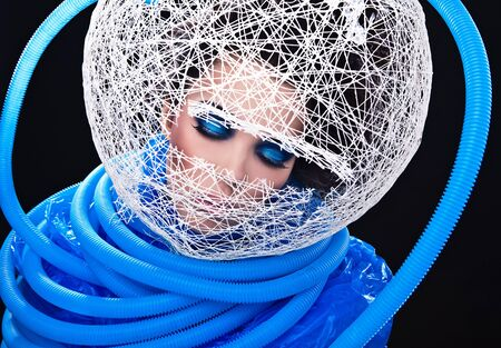 Futuristic beautiful young female face with blue fashion make-up Stock Photo - 15588055