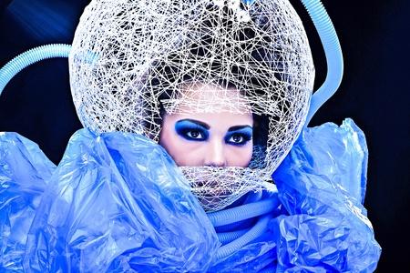 Futuristic beautiful young female face with blue fashion make-up Stock Photo - 15587985