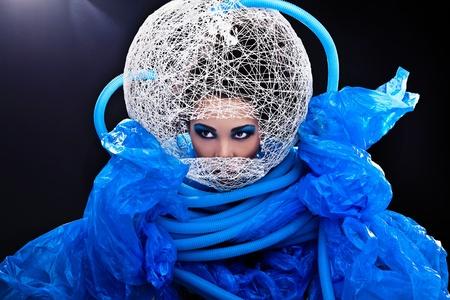 Futuristic beautiful young female face with blue fashion make-up   Stock Photo - 15588063