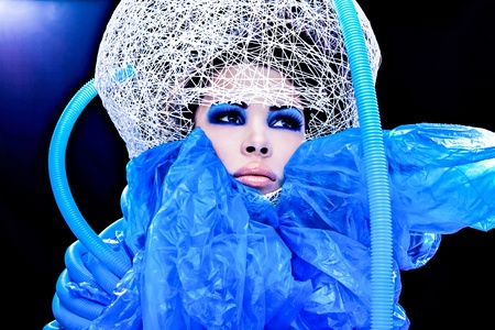 Futuristic beautiful young female face with blue fashion make-up   Stock Photo - 15587994
