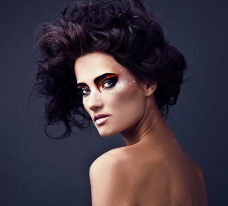 Beautiful young brunette female with bright fashion multicolored make-up  Studio photo Stock Photo - 15587727