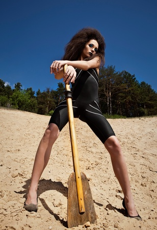 Outdoor fashion shot of young woman in swimsuit   photo