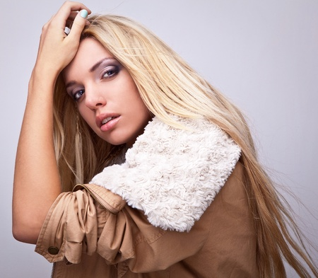 Amazing portrait of beautiful young blond woman on fur   photo