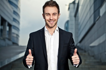 Portrait of a cheerful young businessman  photo