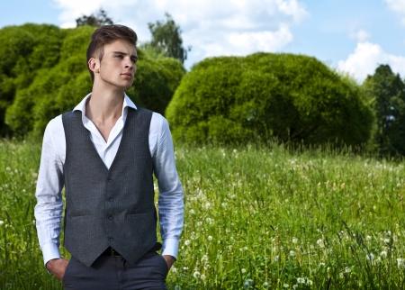 man looking at sky: Good looking beautiful young man outdoor