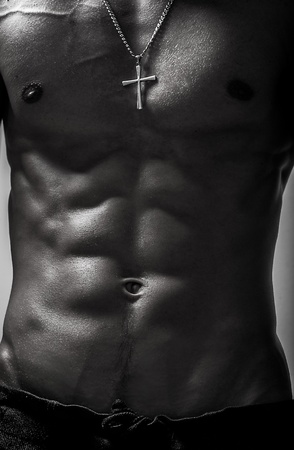 Beauty men torso  Naked body  Isolated on black Stock Photo - 15576009
