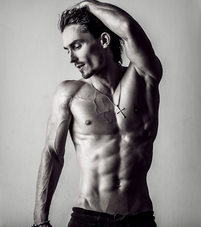 Beautiful and health athletic caucasian muscular young man  Black-white photo   photo