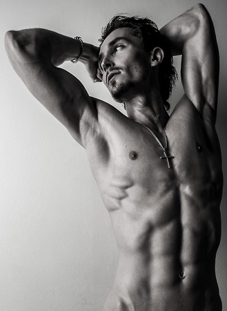 naked black men: Beautiful and health athletic caucasian muscular young man  Black-white photo
