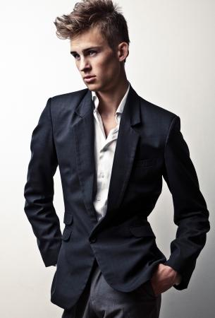 trendy male: Elegant young handsome man  Studio fashion portrait