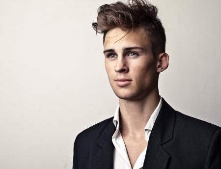 vogue style: Elegant young handsome man  Studio fashion portrait