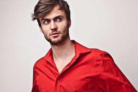 Elegant young handsome man pose on red shirt  Studio fashion portrait Stock Photo - 15576008