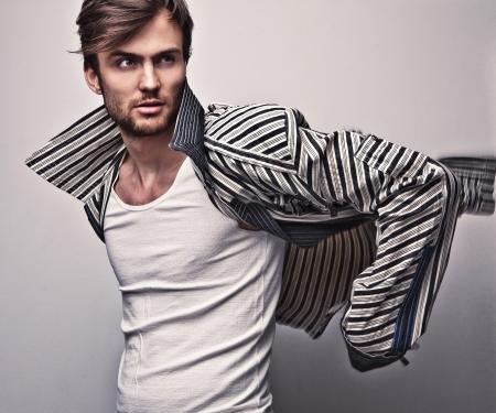 fashion trend: Elegant young handsome man  Studio fashion portrait