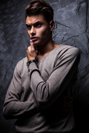 Elegant young handsome man on grunge background  Studio fashion portrait   Stock Photo - 15576999