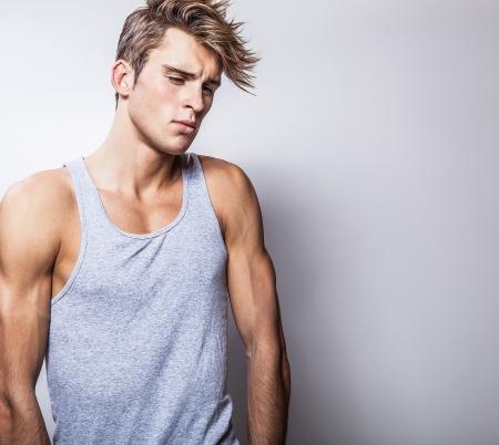 sexy male model: Elegant young handsome man  Studio fashion portrait
