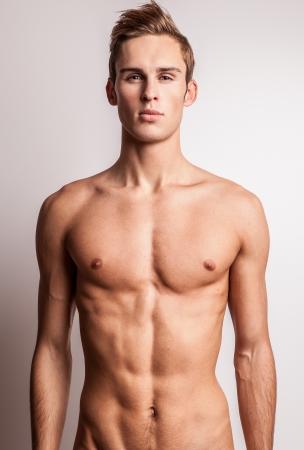 attractive macho: Elegant young handsome man  Studio fashion portrait