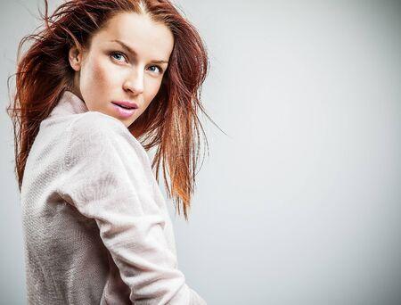 Attractive red hair woman  Studio portrait   photo