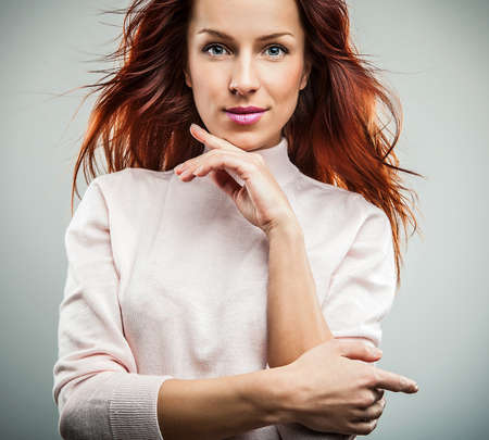 Attractive red hair woman  Studio portrait   photo