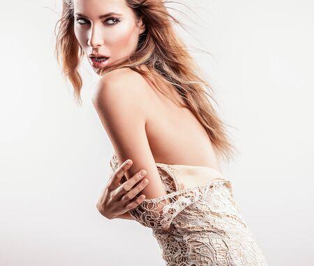 Young sensual model girl pose in studio   photo