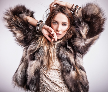 Portrait of attractive stylish woman in fur against grey background   Stock Photo - 17104650