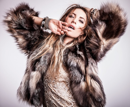 Portrait of attractive stylish woman in fur against grey background Stock Photo - 17130125