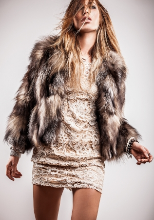 Portrait of attractive stylish woman in fur against grey background Stock Photo - 17104524