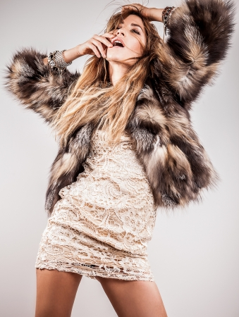 Portrait of attractive stylish woman in fur against grey background Stock Photo - 17104500