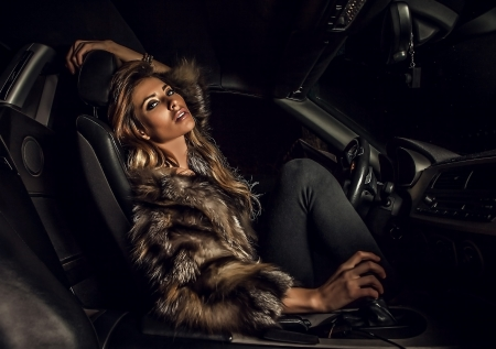 sexy fur: Luxury woman in a car   Stock Photo